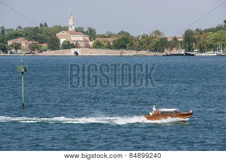 Civil Motorboat In Front Of Lido Island In Summer Venice