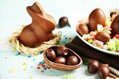 stock photo of easter candy  - Chocolate Easter eggs and rabbit on plate - JPG