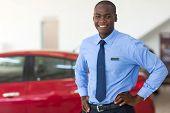 picture of showrooms  - african american vehicle sales consultant inside showroom - JPG