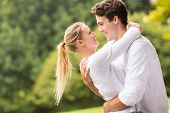 image of flirt  - intimate young couple flirting outdoors - JPG