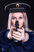 picture of guns  - Beautiful young woman in a marine uniform with a gun over black background  - JPG