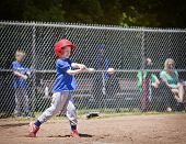 picture of swing  - A youth baseball player takes a nice swing at the ball - JPG