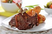 stock photo of lamb  - portrait of grilled lamb chops served with grilled potatoes and mix vegetables - JPG