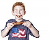 picture of baby back ribs  - Hungry boy eating BBQ rib in studio - JPG