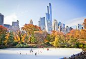 foto of fall trees  - Ice skaters having fun in New York Central Park in fall  - JPG