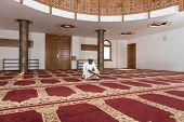 image of islamic religious holy book  - Black African Muslim Man Reading Holy Islamic Book Koran - JPG