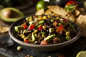 image of dipping  - Homemade Texas Caviar Been Dip with Chips - JPG