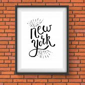 image of memento  - Conceptual Simple New York Texts on a White Picture Frame Hanging on a Brick Wall - JPG