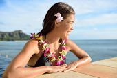 image of waikiki  - Beautiful Asian young adult relaxing in the sun with lei and Diamond Head on Waikiki - JPG