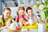picture of enthusiastic  - Children enthusiastic about painting eggs - JPG