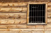 pic of metal grate  - The metal gratings window in the wooden house - JPG