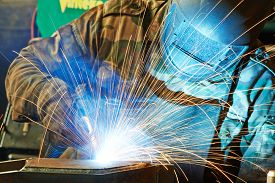 pic of welding  - welder working with electrode at semi - JPG
