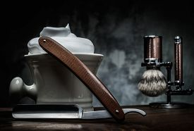 stock photo of razor  - Shaving razors and bowl with foam on wooden background  - JPG