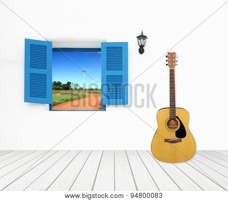 Guitar With Window On Cement Wall And Wood Floor