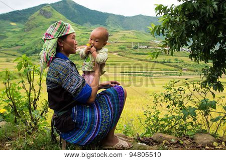 Unidentified H'mong ethnic minority woman with her son in Mucangchai, Vietnam