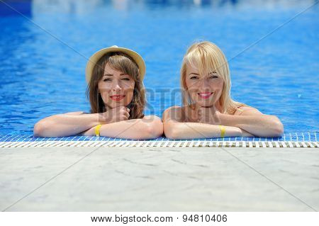 Young Two Girls In A Bikini At The Pool