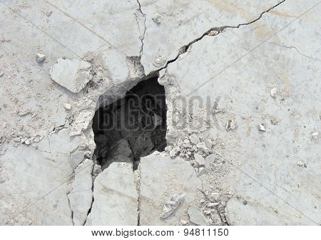 Demolition Hole In A Large Concrete White Plate