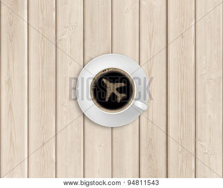 Black coffee in the center of a wooden table