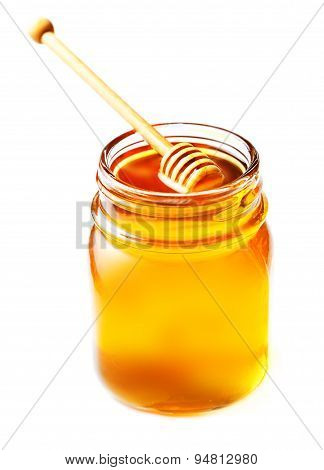 Honey In A Glass Jar With Honey Dipper  Isolated On White Background Close Up. Fresh Honey With A St