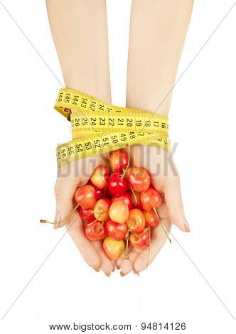 Hands Tied With Measuring Tape Holding Cherries