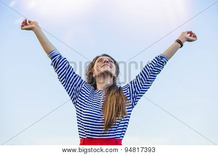 Woman Pulls Hands To The Sunlight Against The Sky