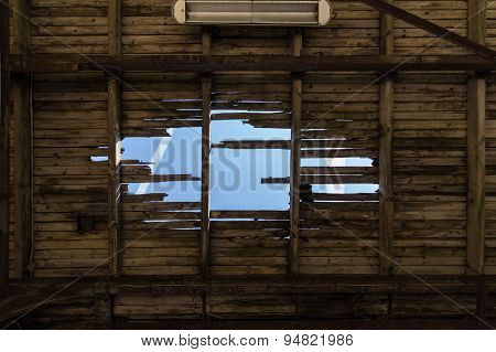 destroyed roof  construction -damaged wooden roof