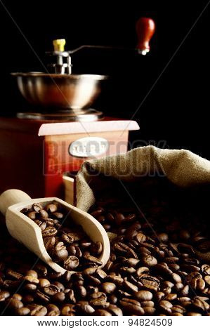 Overturned Bag Full Of Coffee Beans On Black With Spatula,mill