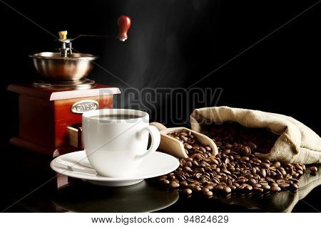 Cup Of Coffee With Saucer,bag,coffee Beans On Black