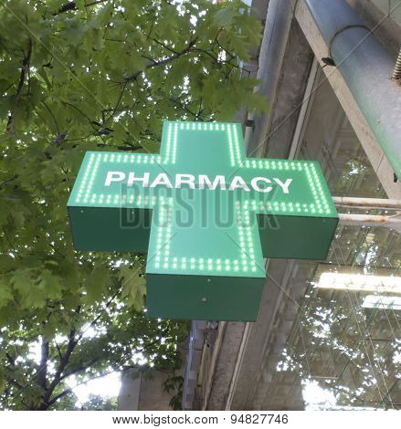 Green , Illuminated Sign On The Pharmacy
