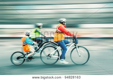Young Family With A Child Ride A Bikes On A City Streets