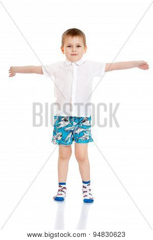 Beautiful little boy in white shirt , shorts and socks are widel