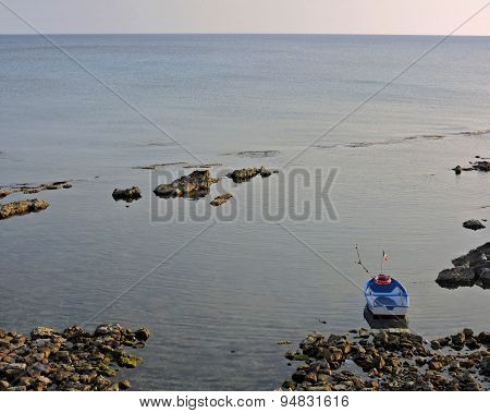 A lonely boat near the coast