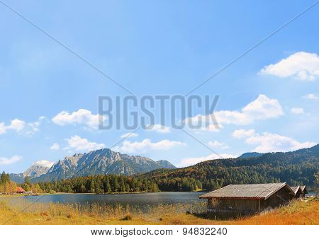 Autumnal Landscape Ferchensee In Bavaria, Blue Sky Background