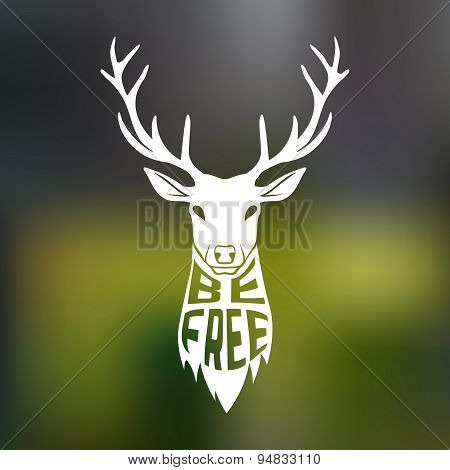 Concept silhouette of deer head with text inside be free on blur background.