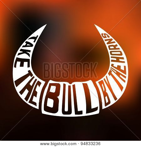 Concept silhouette with text inside take bull by the horns on blur background.