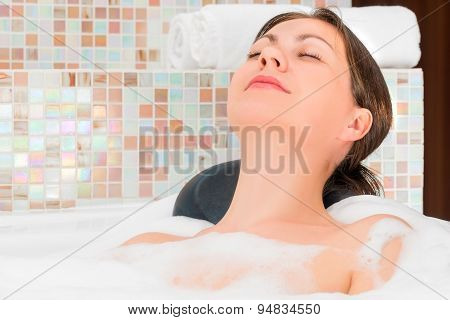 Happy Relaxed Woman Relaxing In The Bath With Foam
