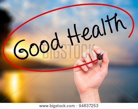 Man Hand writing Good Health with black marker on visual screen