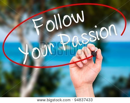 Man Hand writing Follow Your Passion with black marker on visual screen.