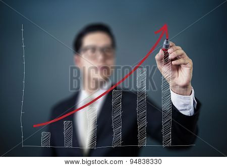 Businessman Hand Writing Graph Of Growth, New Business Concept, Studio Shot