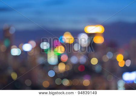 Blur bokeh lights of cityscape during twilight