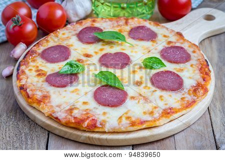 Homemade Pepperoni Pizza On A Wooden Board, Ready To Eat