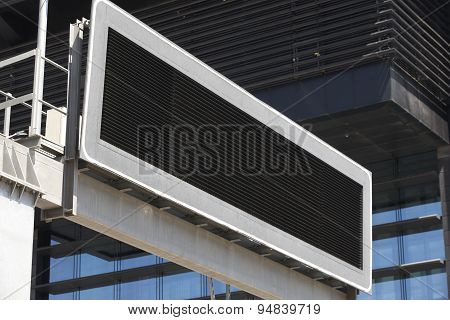Blank Traffic Signpost In The City With Building Facade Background