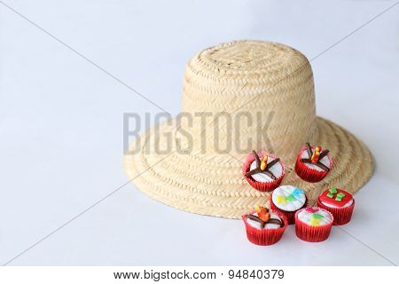 Traditional brasilian hay hat and cupcakes decorated for celebrating St John