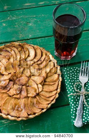 Juicy Apple Pie With Cinnamon And Brandy On A Green Background