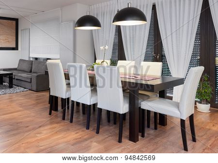 Wooden Table And White Chairs