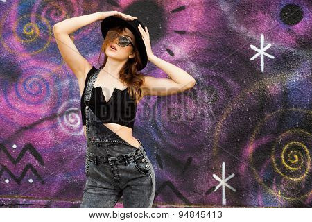 Pretty Teenage Girl Posing Outdoors Dressed Casual On Colorful Graffiti Wall