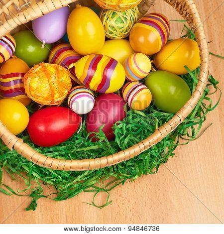 Basket full of colorful Easter eggs