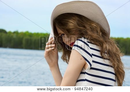 Blond Woman With Long Hair In Summer Day