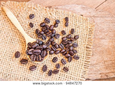 Roasted Coffee Beans In A Wooden Spoonl