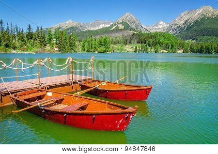Red boats and Tatra Mountains high peaks, Slovakia